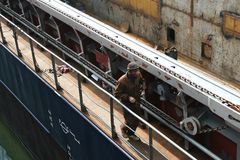 Worker walking on deck. Of an industrial ship Royalty Free Stock Photos
