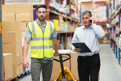 Worker walking with his manager over the phone Stock Photography