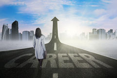 Worker walking on the path with career text stock photos