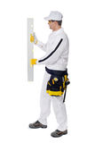 Worker wall level on white background Stock Photos
