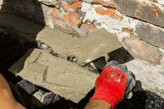 Worker with wall plastering tools renovating house Stock Photo