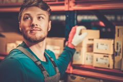 Worker on a warehouse. Worker on a automotive spare parts warehouse royalty free stock photos