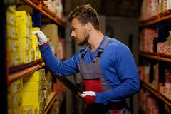 Worker on a warehouse Royalty Free Stock Image