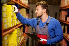 Worker on a warehouse Royalty Free Stock Photography