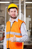 Worker in warehouse. Happy young male worker in uniform in warehouse Royalty Free Stock Photography