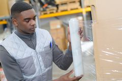 Worker in warehouse during press tour. Worker in the warehouse during the press tour Stock Photos