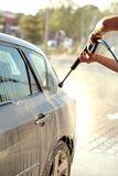 Worker wash the car with high pressure washer. Male worker wash the car with high pressure washer Stock Images