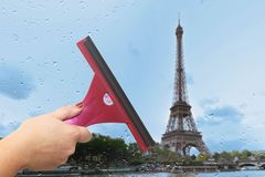 Worker washes the window after the rain. Paris. Tower Stock Photography