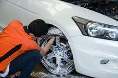 Worker Washing Car`s Alloy wheel Stock Photo