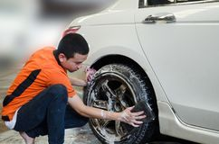 Worker Washing Car`s Alloy wheel Stock Image