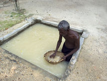 Worker washing moonstone gems Stock Photo