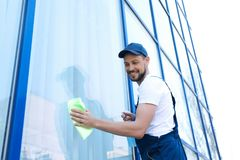 Worker washing window glass from outside. Male worker washing window glass from outside Royalty Free Stock Photo