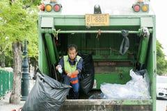 Worker in waste trucks, Thailand 21 July 2017 : sanitation worke. R being waste separation Royalty Free Stock Image