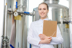 Worker at a water factory. Female young attractive specialist at water factory Stock Photos