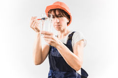 Worker with water glass Royalty Free Stock Photo
