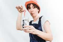 Worker with water glass Royalty Free Stock Photography