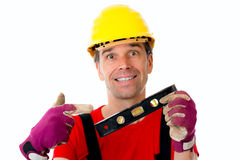 Worker with water-level Royalty Free Stock Image