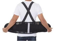 Worker wear back support belts for support and improve back post Royalty Free Stock Photos
