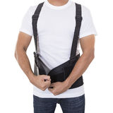 Worker wear back support belts for support and improve back post Stock Image