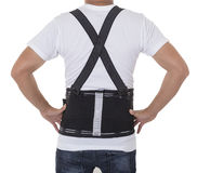 Worker wear back support belts for support and improve back post Stock Photo