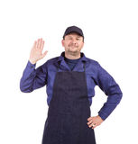 Worker wearing black apron. Royalty Free Stock Images