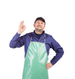 Worker wearing blue apron. Royalty Free Stock Image
