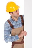 Worker wearing hard hat and holding empty banner Stock Photo