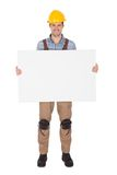 Worker wearing hard hat and holding empty banner Royalty Free Stock Photo