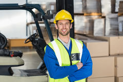 Worker wearing hard hat in warehouse Stock Image