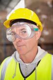 Worker wearing hard hat in warehouse Royalty Free Stock Photo
