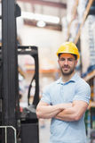 Worker wearing hard hat in warehouse Royalty Free Stock Image
