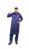 Worker wearing long robe. Stock Image