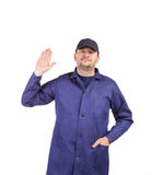 Worker wearing long robe. Stock Images