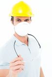 Worker wearing mask and hardhat while holding protective glasses Royalty Free Stock Photo