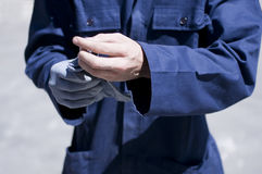 Worker wearing protection gloves Royalty Free Stock Photo