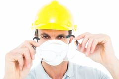 Worker wearing protective glasses over white background Stock Image