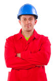 Worker wearing in red jacket and blue hardhat Royalty Free Stock Photography