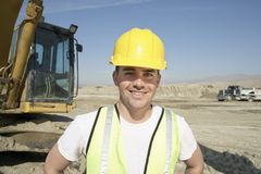 Worker Wearing Reflective Vest And Hardhat Royalty Free Stock Photos