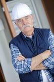 Worker wearing safety headgear. Work Royalty Free Stock Image