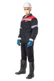Worker wearing safety protective gear. Full length portrait of young worker wearing safety protective gear isolated on white background Royalty Free Stock Photo