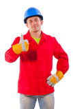 Worker wearing working clothes demonstrating ok fi Stock Photos
