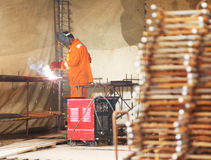 Worker weld metal gratings by acetylene torch Stock Images