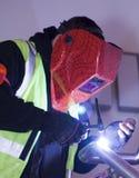 Worker Welded. Construction worker welding metal tubes royalty free stock photos