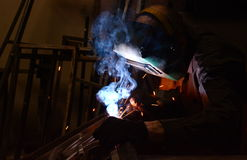 Worker-welder welds metal Royalty Free Stock Photos