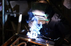 Worker-welder welds metal Stock Photography