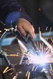 Worker Welding. Close up of a welding with many sparks Stock Photography