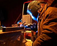 Worker welding construction by Royalty Free Stock Images