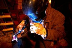 Worker welding construction by Stock Photos
