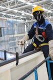 Worker welding crane rails indoor Stock Photos