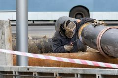 Worker welding gas line Royalty Free Stock Image
